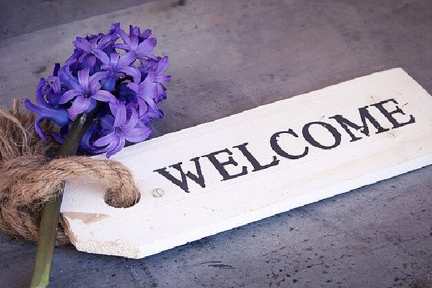 New here? Welcome sign with flower